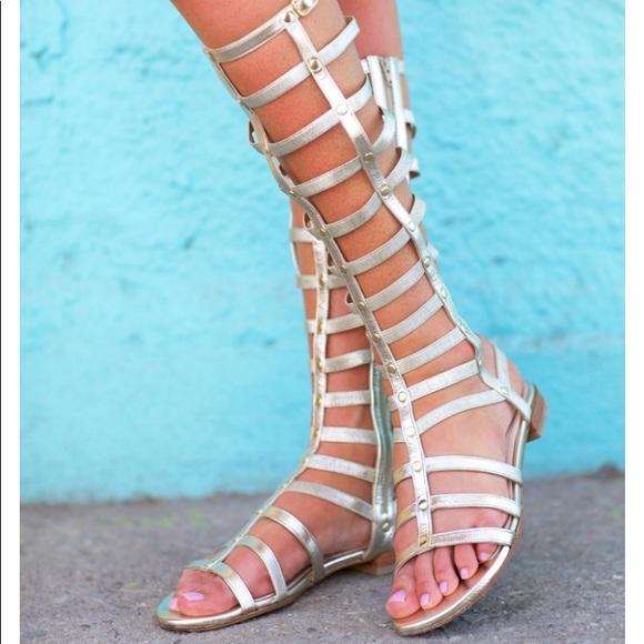 6ec65761c Stuart Weitzman Gold Gladiator Sandals. M_5acfa92684b5ce10620eb669